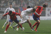 Christopher Wood of New Zealand compete for the ball with Park Joo-Ho and Han Kook-Young of South Korea during the international friendly match between South Korea and New Zealand at Seoul World Cup Stadium on March 31, 2015 in Seoul, South Korea.