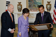 South Korean President Park Geun-hye (C) receives a Los Angeles City proclamation from Los Angeles Mayor Antonio Villaraigosa (R) as California Governor Jerry Brown looks on during a welcoming luncheon at the Getty House on May 9, 2013 in Los Angeles, California. Park will visit Korean business leaders in Los Angeles today as she continues a five-day, unity-building visit to the United States. Park has been in the United States since Monday, when she visited the United Nations. She met with President Barack Obama on Tuesday and addressed a joint session of Congress on Wednesday.