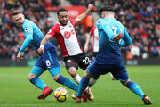 Aaron Ramsey and Sead Kolasinac of Arsenal battle for possession with Nathan Redmond of Southampton during the Premier League match between Southampton and Arsenal at St Mary's Stadium on December 9, 2017 in Southampton, England.