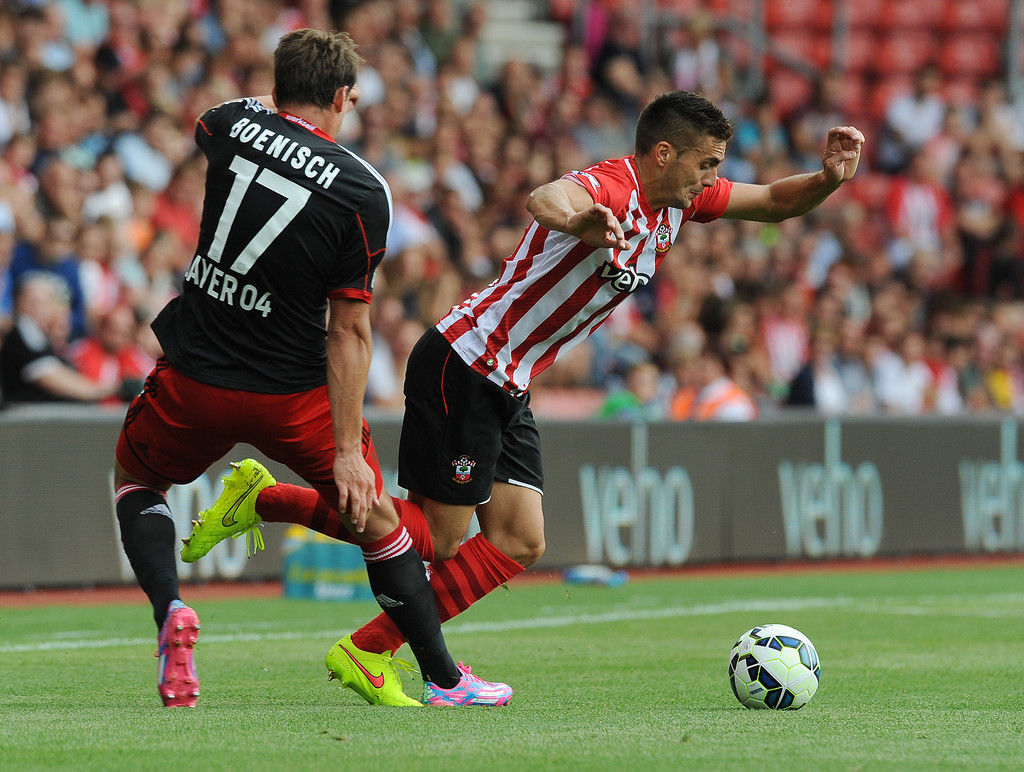 of Southampton is challenged by Omer Toprak of Bayer Leverkusen ...