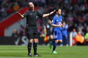 Referee Mike Dean reacts during the Premier League match between Southampton and Chelsea at St Mary's Stadium on April 14, 2018 in Southampton, England.