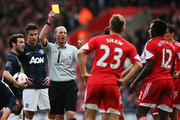 Victor Wanyama of Southampton is booked by match referee Mike Dean during the Barclays Premier League match between Southampton and Manchester United at St Mary's Stadium on May 11, 2014 in Southampton, England.
