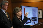 """Randi Weingarten (R), President of the American Federation of Teachers, and Richard Cohen (L), President of the Southern Poverty Law Center, speak during a press conference November 29, 2016 in Washington, DC. During the press conference the Southern Poverty Law Center, in conjunction with additional human rights groups and education leaders, called on U.S. President-elect Donald Trump to """"immediately and forcefully publicly denounce racism and bigotry."""""""