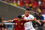 Pedro Rodriguez of Spain and Gonzalo Jara of Chile compete for the ball during the 2014 FIFA World Cup Brazil Group B match between Spain and Chile at Maracana on June 18, 2014 in Rio de Janeiro, Brazil.