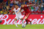 Fernando Torres of Spain controls the ball against Gonzalo Jara of Chile during the 2014 FIFA World Cup Brazil Group B match between Spain and Chile at Maracana on June 18, 2014 in Rio de Janeiro, Brazil.