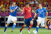 Cesc Fabregas (C) of Spain battles for the ball with Giorgio Chiellini (L) and Andrea Pirlo of Italy during the UEFA EURO 2012 final match between Spain and Italy at the Olympic Stadium on July 1, 2012 in Kiev, Ukraine.
