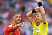Sergio Ramos of Spain of Spain argues with referee Bjorn Kuipers after he awards Russia with a penalty following a handball during the 2018 FIFA World Cup Russia Round of 16 match between Spain and Russia at Luzhniki Stadium on July 1, 2018 in Moscow, Russia.