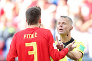 Gerard Pique of Spain  of Spain argues with referee Bjorn Kuipers after he awards Russia with a penalty during the 2018 FIFA World Cup Russia Round of 16 match between Spain and Russia at Luzhniki Stadium on July 1, 2018 in Moscow, Russia.