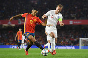 Thiago Alcantara of Spain and Harry Kane of England battle for the ball during the UEFA Nations League A Group Four match between Spain and England at Estadio Benito Villamarin on October 15, 2018 in Seville, Spain.