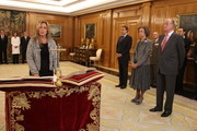 Newly appointed  Foreign Minister Trinidad Jimenez signs the oath of office as Spanish King Juan Carlos (R) and Queen Sofia (2nd-R) receives new ministers at Zarzuela Palace on October 21, 2010 in Madrid, Spain. Spain's Prime Minister Jose Luis Rodriguez Zapatero announced on Wednesday, October 20, 2010 a major reshuffle of his cabinet ministers as his Socialist party trails in the polls amid economic difficulties in Spain.