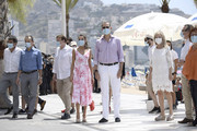 Queen Letizia of Spain and King Felipe VI of Spain walk through the seafront of Levante's beach on July 03, 2020 in Benidorm, Spain. This trip is part of a royal tour that will take King Felipe and Queen Letizia through several Spanish Autonomous Communities with the objective of supporting economic, social and cultural activity after the Coronavirus outbreak.