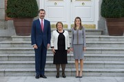 King Felipe VI of Spain (L) and Queen Letizia of Spain (R) receive Chilean President Michelle Bachelet (C) at the Zarzuela Palace on October 29, 2014 in Madrid, Spain.