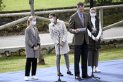 King Felipe of Spain makes a speech  during his visit to Somao, which has been honoured as the 2020 Best Asturian Village, with Queen Letizia and daughters Princess Leonor and Princess Sofia, the day after the 'Princesa de Asturias' Awards on October 17, 2020 in Somao, Spain.