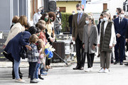 King Felipe and Queen Letizia of Spain with their daughters Princess Leonor and Princess Sofia meet young children during their visit to Somao, which has been honoured as the 2020 Best Asturian Village, the day after the 'Princesa de Asturias' Awards on October 17, 2020 in Somao, Spain.