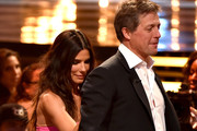 "Actors Sandra Bullock (L) and Hugh Grant speak onstage during Spike TV's ""Guys Choice 2014"" at Sony Pictures Studios on June 7, 2014 in Culver City, California."