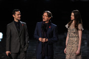 "(L-R) Actors Joseph Gordon-Levitt, Gary Oldman, and Anne Hathaway accept an award onstage during Spike TV's ""SCREAM 2011"" awards held at Universal Studios on October 15, 2011 in Universal City, California."