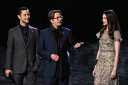 "Actors Joseph Gordon-Levitt, Gary Oldman, and Anne Hathaway accept an award onstage during Spike TV's ""SCREAM 2011"" awards held at Universal Studios on October 15, 2011 in Universal City, California."
