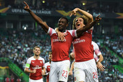 Danny Welbeck (L) of Arsenal FC celebrates with his team mate Matteo Guedouzi after scoring his team's first goalduring the UEFA Europa League Group E match between Sporting CP and Arsenal at Estadio Jose Alvalade on October 25, 2018 in Lisbon, Portugal.