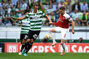 Radosav Petrovic of Sporting CP and Aaron Ramsey of Arsenal in action during the UEFA Europa League Group E match between Sporting CP and Arsenal at Estadio Jose Alvalade on October 25, 2018 in Lisbon, Portugal.