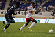 Lloyd Sam #10 of the New York Red Bulls plays the ball against Kei Kamara #23 of the Sporting KC at Red Bull Arena on September 19, 2012 in Harrison, New Jersey. Sporting Kansas City defeated New York Red Bulls 2-0.