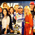 Angie Harmon Jason Sehorn Photos - Jimmie Johnson (4R), driver of the #48 Lowe's Patriotic Chevrolet, poses in victory lane with wife Chandra (3R), actress Angie Harmon (R), her husband/former football player Jason Sehorn (2R), Crew cheif Chad Knaus (L) and his girlfriend Lisa Rockelmann (2L) after winning the NASCAR Sprint All-Star Race at Charlotte Motor Speedway on May 19, 2012 in Charlotte, North Carolina. - Sprint All-Star Race