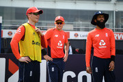 The England 12th man Eoin Morgan with Sam Curran and Moeen Ali during the 5th One Day International match between Sri Lanka and England at R. Premadasa Stadium on October 23, 2018 in Colombo, Sri Lanka.