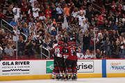 Luke Schenn #2, Christian Fischer #36, Oliver Ekman-Larsson #23, Dylan Strome #20 and Max Domi #16 of the Arizona Coyotes celebrate after Schenn scored a goal against the St. Louis Blues during the first period of the NHL game at Gila River Arena on March 31, 2018 in Glendale, Arizona.
