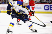 Brayden Schenn #10 of the St. Louis Blues advances the puck against the Chicago Blackhawks at the United Center on March 18, 2018 in Chicago, Illinois.
