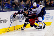Brandon Dubinsky #17 of the Columbus Blue Jackets and Robert Bortuzzo #41 of the St. Louis Blues battle for control of the puck during the second period on March 24, 2018 at Nationwide Arena in Columbus, Ohio.