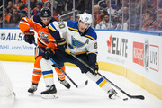Kris Russell #4 of the Edmonton Oilers battles against Alexander Steen #20 of the St. Louis Blues at Rogers Place on December 21, 2017 in Edmonton, Canada.