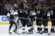 Goaltender Jonathan Quick #32 and Colin Fraser #24 of the Los Angeles Kings celebrate their teams 2-1 victory over the St. Louis Blues in Game Six of the Western Conference Quarterfinals during the 2013 NHL Stanley Cup Playoffs at Staples Center on May 10, 2013 in Los Angeles, California.