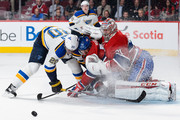 Alexander Steen #20 of the St. Louis Blues and Andrei Markov #79 of the Montreal Canadiens crash into goaltender Carey Price #31 during the NHL game at the Bell Centre on October 20, 2015 in Montreal, Quebec, Canada.