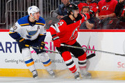 Adam Henrique #14 of the New Jersey Devils reaches for the puck in the second period against Alexander Steen #20 of the St. Louis Blues on November 7, 2017 at Prudential Center in Newark, New Jersey.