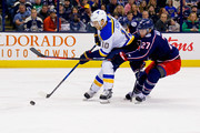 Ryan Murray #27 of the Columbus Blue Jackets attempts to stick check Brayden Schenn #10 of the St. Louis Blues during the third period on March 24, 2018 at Nationwide Arena in Columbus, Ohio. St. Louis defeated Columbus 2-1.