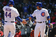 Anthony Rizzo #44 of the Chicago Cubs is greeted by Addison Russell #27 after scoring a run in the 2nd inning against the St. Louis Cardinals at Wrigley Field on April 19, 2018 in Chicago, Illinois.