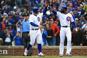 Anthony Rizzo #44 of the Chicago Cubs celebrates with Jason Heyward #22 after scoring a run in the fifth inning against the St. Louis Cardinals at Wrigley Field on September 30, 2018 in Chicago, Illinois.