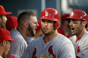 Matt Holliday #7 of the St. Louis Cardinals celebrates his three run homerun with teammates in the seventh inning during Game One of the National League Division Series against the Los Angeles Dodgers at Dodger Stadium on October 3, 2014 in Los Angeles, California.