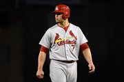 Matt Holliday #7 of the St Louis Cardinals waits at first base after hitting a single in the fifth inning against the Los Angeles Dodgers at Dodger Stadium on June 27, 2014 in Los Angeles, California.