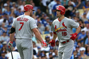 Randal Grichuk #15 of the St. Louis Cardinals celebrates with teammate Matt Holliday #7  after hitting a homerun to score in the first inning of Game One of the National League Division Series at Dodger Stadium on October 3, 2014 in Los Angeles, California.