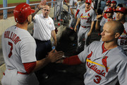 Matt Holliday (L) #7 of the St Louis Cardinals is congratulated by teammate Mark Ellis #3 after scoring in the fifth inning against the Los Angeles Dodgers at Dodger Stadium on June 27, 2014 in Los Angeles, California.