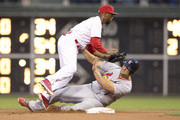 Left fielder Matt Holliday #7 of the St. Louis Cardinals slides into shortstop Jimmy Rollins #11 of the Philadelphia Phillies in attempt to break up a double play in the top of the first inning on August 23, 2014 at Citizens Bank Park in Philadelphia, Pennsylvania.