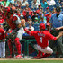 Andres Blanco Photos - Andres Blanco #4 of the Philadelphia Phillies slides safely into home plate in the fifth inning during a game against the St. Louis Cardinals at Citizens Bank Park on June 22, 2017 in Philadelphia, Pennsylvania. The Phillies won 5-1. - St Louis Cardinals v Philadelphia Phillies