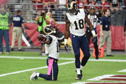 Wide receiver Tavon Austin #11 of the St Louis Rams (left) celebrates his fourth quarter touchdown with wide receiver Kenny Britt #18 during the NFL game against the Arizona Cardinals at University of Phoenix Stadium on October 4, 2015 in Glendale, Arizona.
