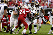 Quarterback Keith Null #9 of the St. Louis Rams is sacked by Adrian Wilson #24 of the Arizona Cardinals during the second quarter of the NFL game at the Universtity of Phoenix Stadium on December 27, 2009 in Glendale, Arizona.