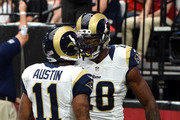 Wide receiver Tavon Austin #11 of the St Louis Rams (left) celebrates his first quarter touchdown with wide receiver Kenny Britt #18 (right) during the NFL game against the Arizona Cardinals at University of Phoenix Stadium on October 4, 2015 in Glendale, Arizona.