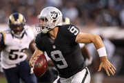 Christian Ponder #9 of the Oakland Raiders scrambles with the ball against the St. Louis Rams at O.co Coliseum on August 14, 2015 in Oakland, California.