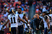 Tavon Austin #11 of the St. Louis Rams celebratres with teammate  Kenny Britt #81 of the St. Louis Rams after Austin returned a punt for a second half touchdown against the Washington Redskins at FedExField on December 7, 2014 in Landover, Maryland. The Rams won 24-0.