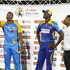 Jason Holder Photos - In this handout image provided by CPL T20,  Kieron Pollard (L) of St Lucia Stars toss the coin as Jason Holder (C) of Barbados Tridents and match referee Denavon Hayles (R) look on at the start of match 10 of the Hero Caribbean Premier League between St Lucia Stars and Barbados Tridents at the Darren Sammy Cricket Ground on August 17, 2018 in Gros Islet, Saint Lucia. - St Lucia Stars v Barbados Tridents - 2018 Hero Caribbean Premier League (CPL) Tournament