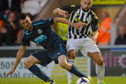 Haris Vuckic of Newcastle tackles Darren McGregor of St Mirren during the Pre Season Friendly match between St Mirren and Newcastle United at St Mirren Park on July 30, 2013 in Paisley, Scotland.