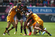 Jonathan Danty of Stade Francais looks to hand off Chris Bell of Wasps during the European Rugby Champions Cup Play-off match between Stade Francais Paris and London Wasps at Stade Jean-Bouin on May 24, 2014 in Paris, France.
